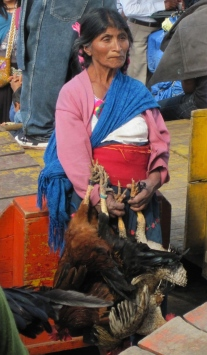 Woman at the Market to sell her Chickens